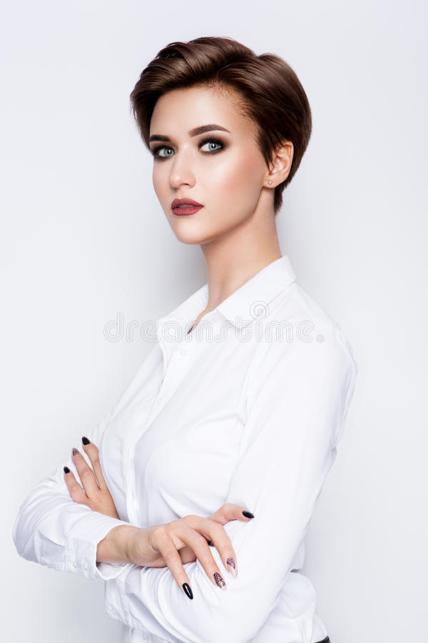 Portrait of beautiful girl with short hair. Portrait of beautiful girl with beautiful make up and short hair royalty free stock photo