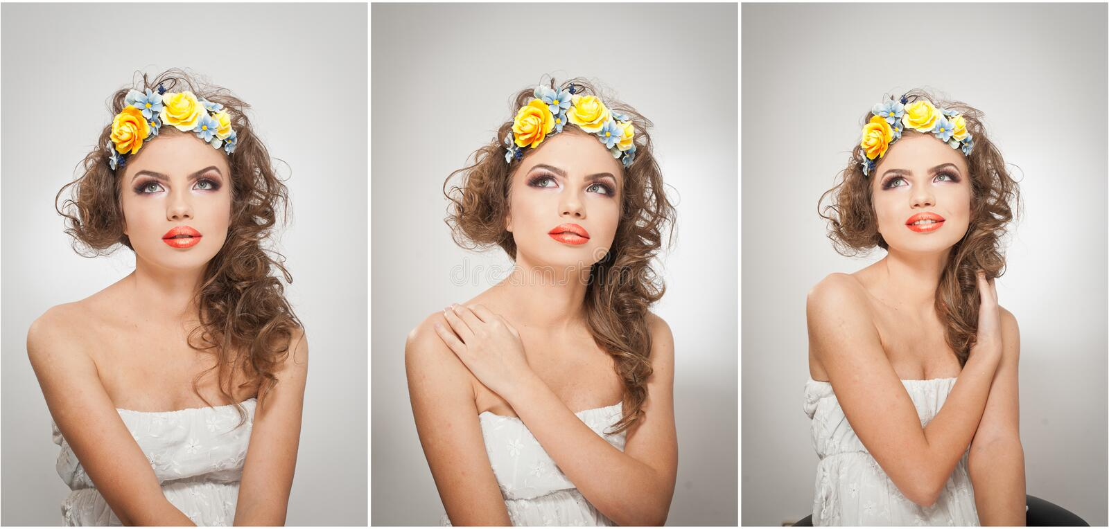 Portrait of beautiful girl in studio with yellow roses in her hair and naked shoulders. young woman with professional makeup royalty free stock photo