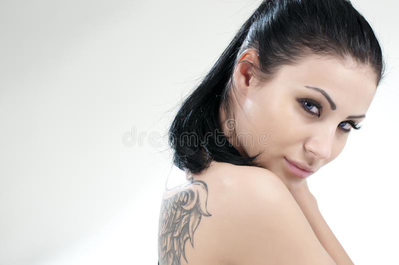 Portrait of beautiful girl with tattoo royalty free stock photo