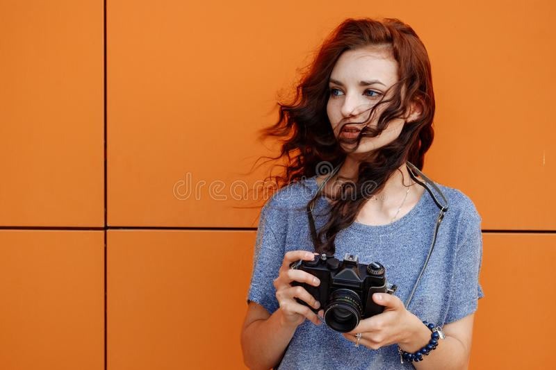 Portrait of a beautiful girl using a vintage film 35mm camera royalty free stock images