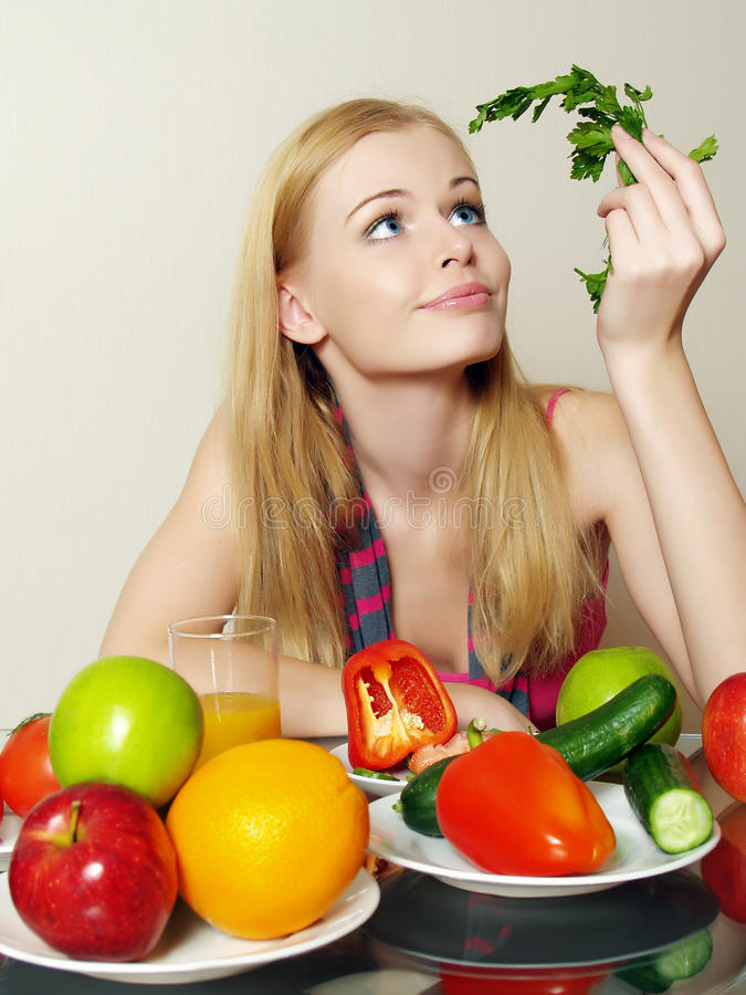 Portrait of beautiful girl with vegetable. And fruit royalty free stock photo