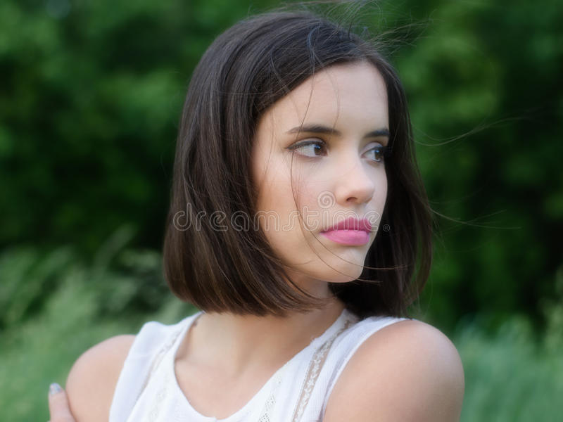 Portrait of beautiful girl walking in nature on colorful summer day royalty free stock photo