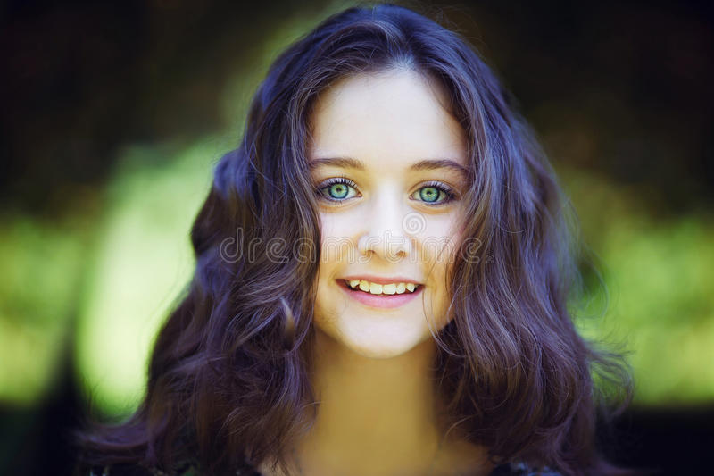 Portrait of beautiful girl. Portrait of young beautiful girl in a park royalty free stock photo