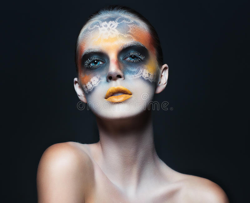 Portrait of beautiful glamor girl with dark eye make-up in the f royalty free stock photos