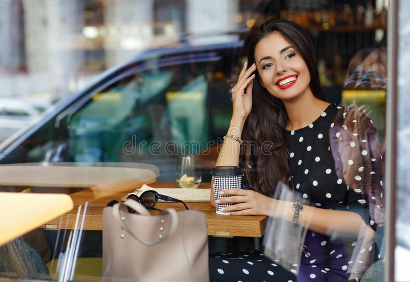 Portrait of a beautiful glamorous and stylish brunette girl in a royalty free stock image