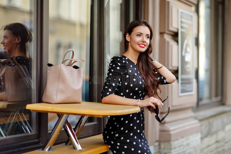 Portrait of a beautiful glamorous and stylish brunette girl in a royalty free stock photography