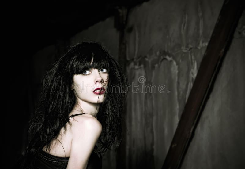 Portrait of beautiful goth girl looking back stock photos