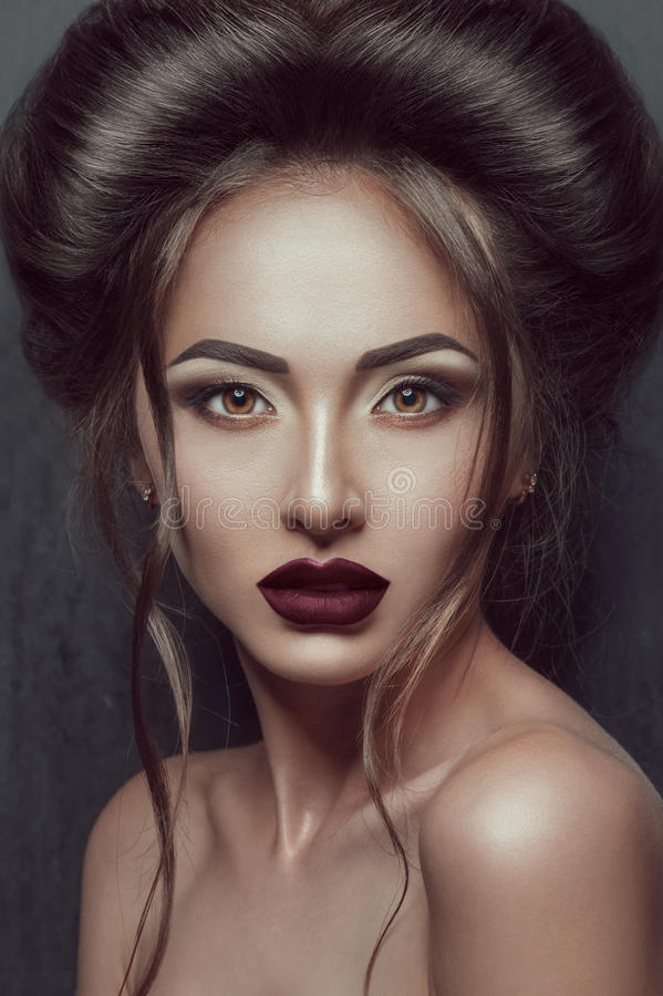Portrait of Beautiful gothic girl with awesome makeup and hairstyle stock images