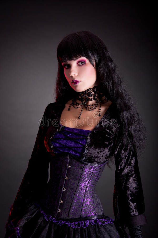 Portrait of beautiful gothic girl wearing Halloween costume royalty free stock photography