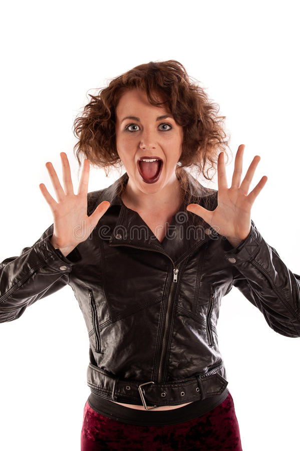 Portrait of a beautiful gothic woman in black leather jacket. In a studio stock photo