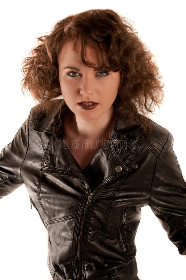 Portrait of a beautiful gothic woman in black leather jacket. In a studio stock image