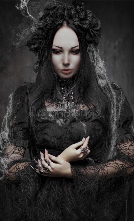 Portrait of beautiful Gothic woman in dark dress royalty free stock image