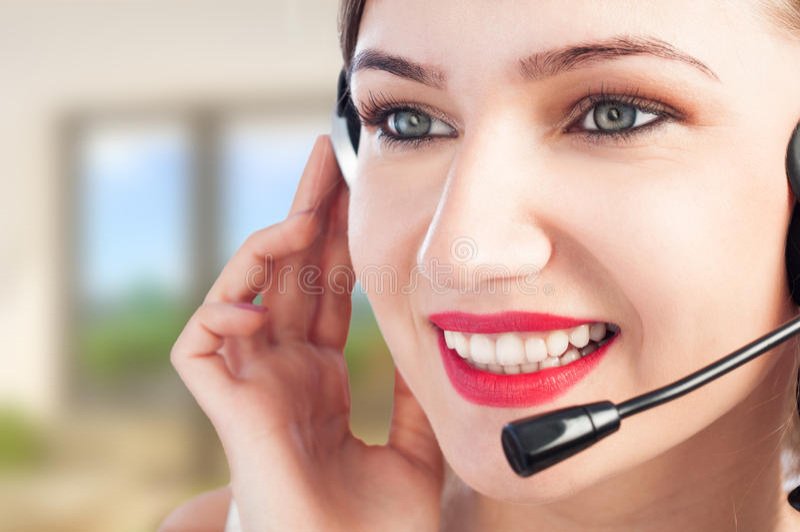 Portrait of beautiful happy customer representative at office stock photography