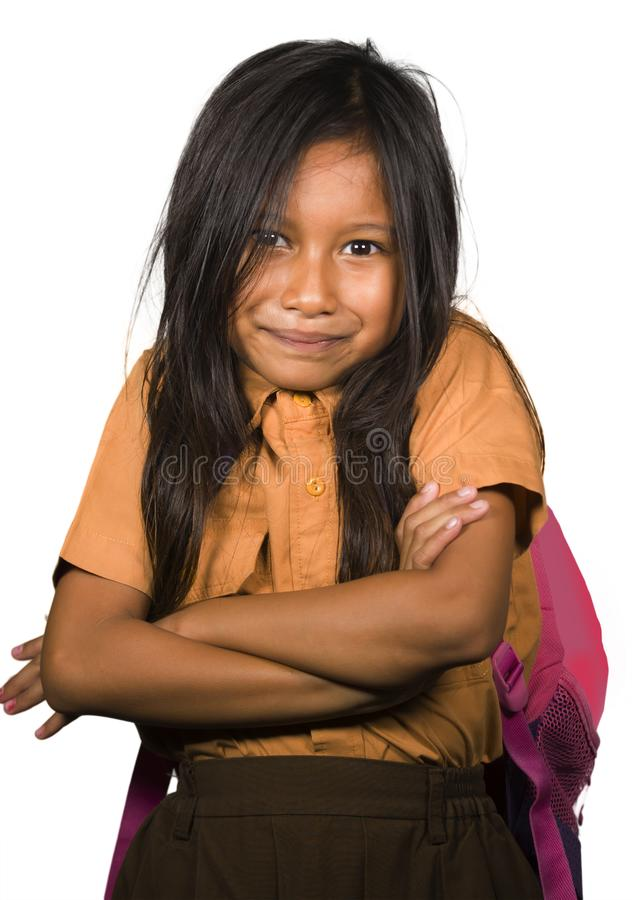 Portrait of beautiful happy and excited female child in school uniform carrying student bag smiling cheerful isolated on white. Background in back to school and stock photos