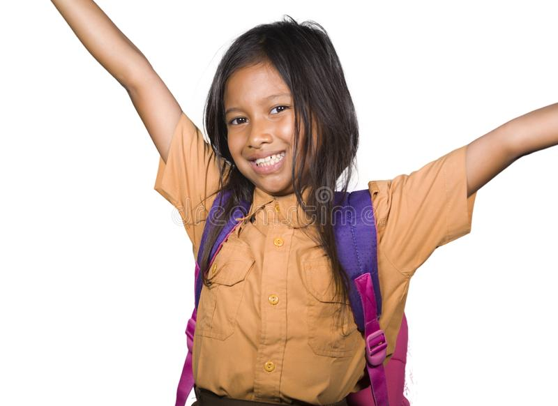 Portrait of beautiful happy and excited female child in school uniform carrying student bag smiling cheerful isolated on white. Background in back to school and stock image