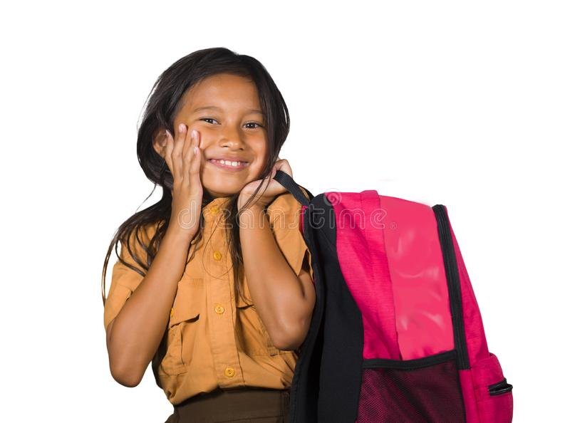 Portrait of beautiful happy and excited female child in school uniform carrying student bag smiling cheerful isolated on white. Background in back to school and royalty free stock photos