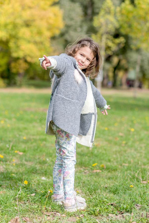 Portrait of beautiful girl. Portrait of beautiful and happy girl outdoor with Autumn background royalty free stock image