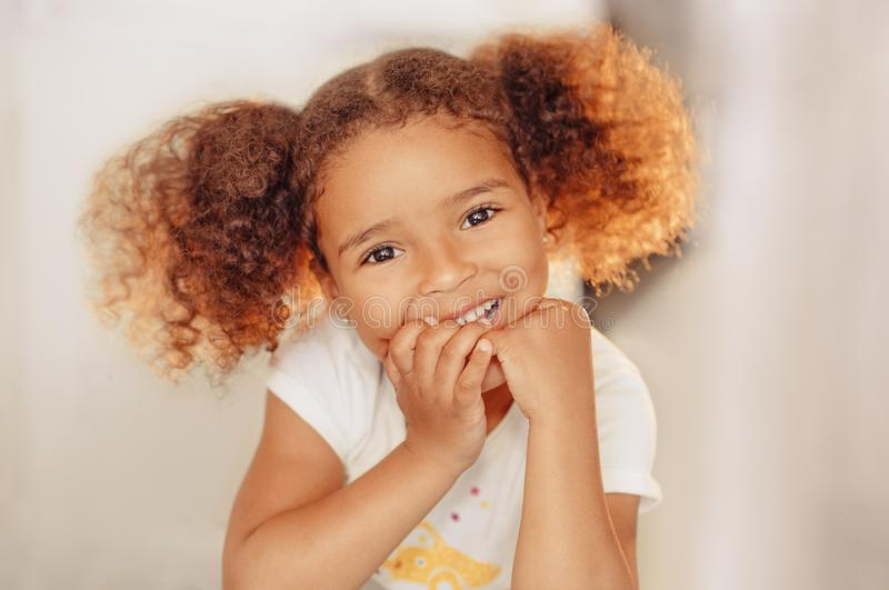 Portrait of a beautiful happy liitle girl close-up royalty free stock image