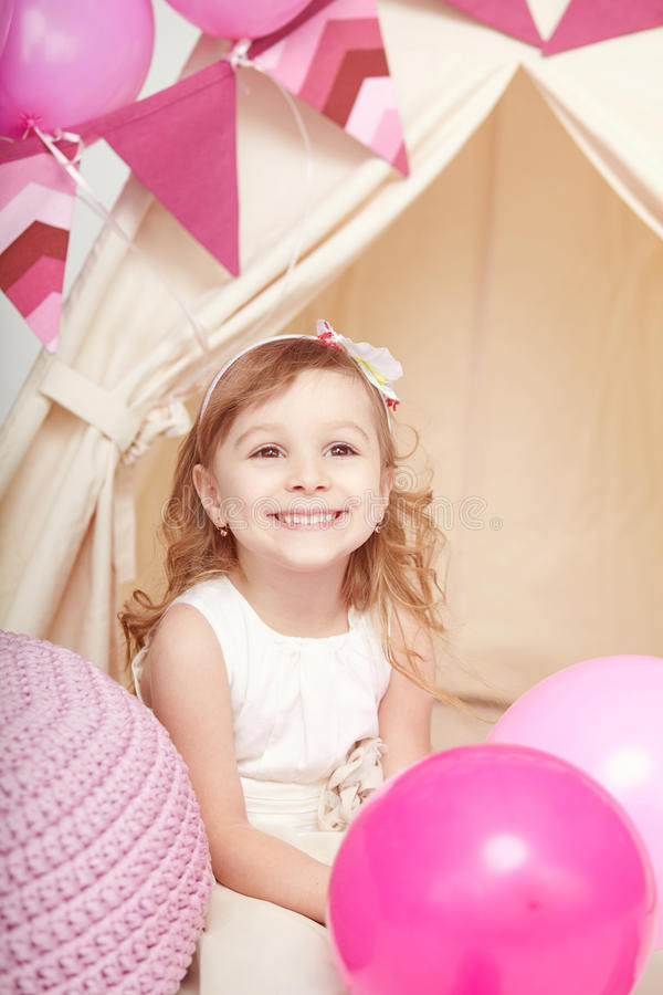 Portrait of beautiful happy little girl with balloon stock image