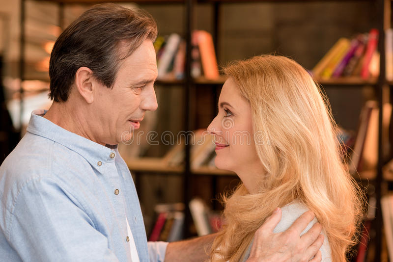 Portrait of beautiful happy mature couple looking at each other royalty free stock photos