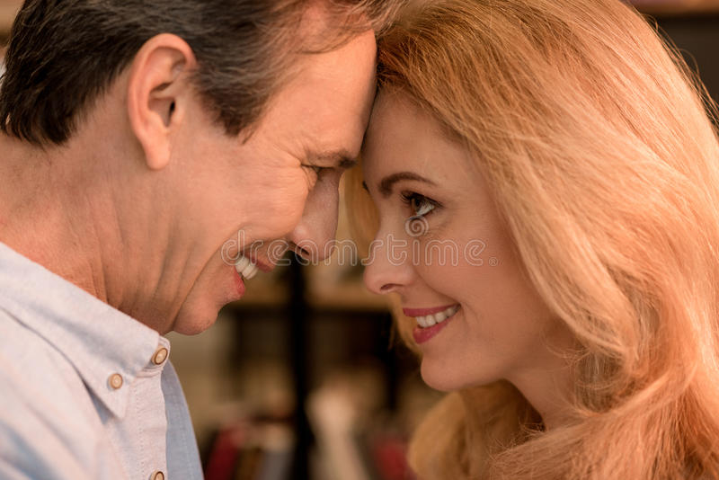 Portrait of beautiful happy mature couple looking at each other stock photography