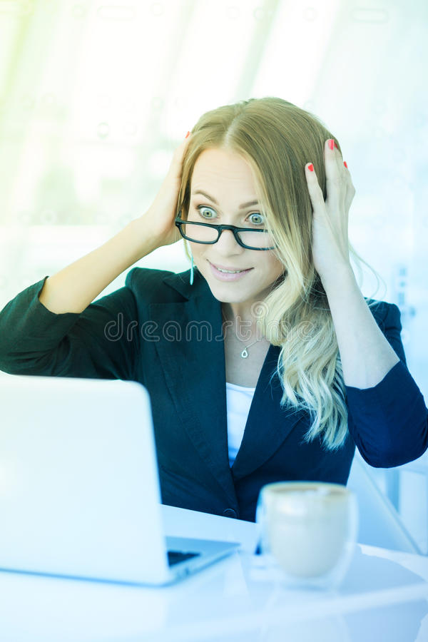 Portrait of beautiful happy smiling young office woman working o stock image