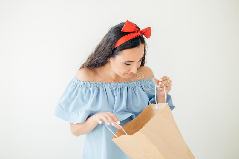 Portrait beautiful happy surprised woman girl holding in her hands shopping bag stock photography