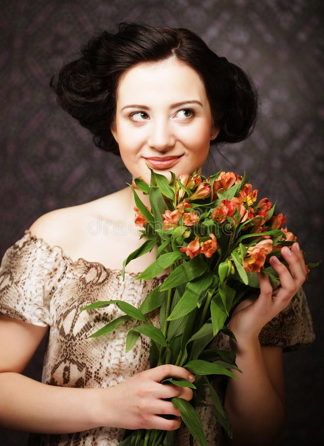 Young attractive young girl holds the bouquet of red and yellow stock photography
