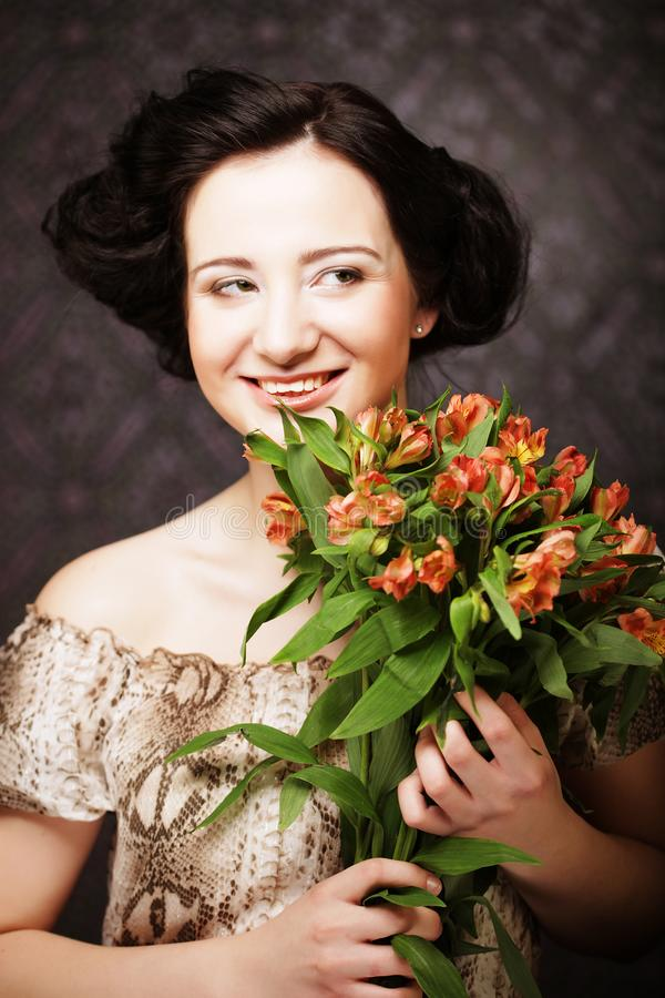 Young attractive young girl holds the bouquet of red and yellow royalty free stock photos