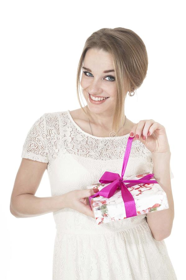 Portrait of beautiful happy woman with a gift box. royalty free stock photos