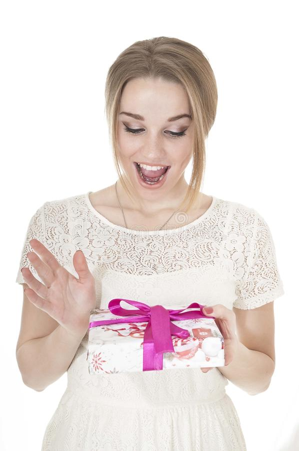 Portrait of beautiful happy woman with a gift box. royalty free stock photography