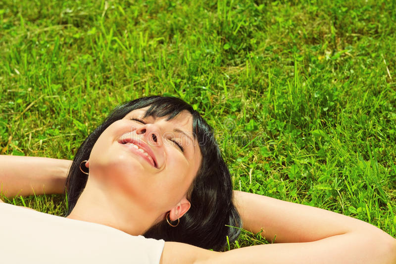 Portrait of a beautiful happy woman in nature. Portrait of a beautiful young happy woman in nature stock photos