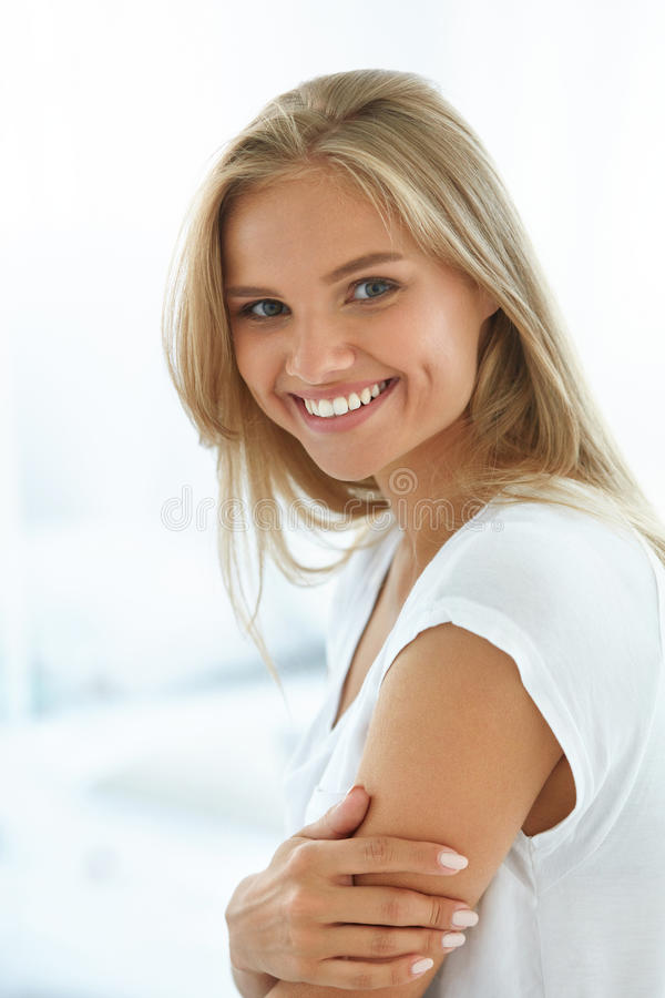 Portrait Beautiful Happy Woman With White Teeth Smiling. Beauty. Beautiful Woman Smiling. Portrait Of Attractive Happy Healthy Girl With Perfect Smile, White royalty free stock photography