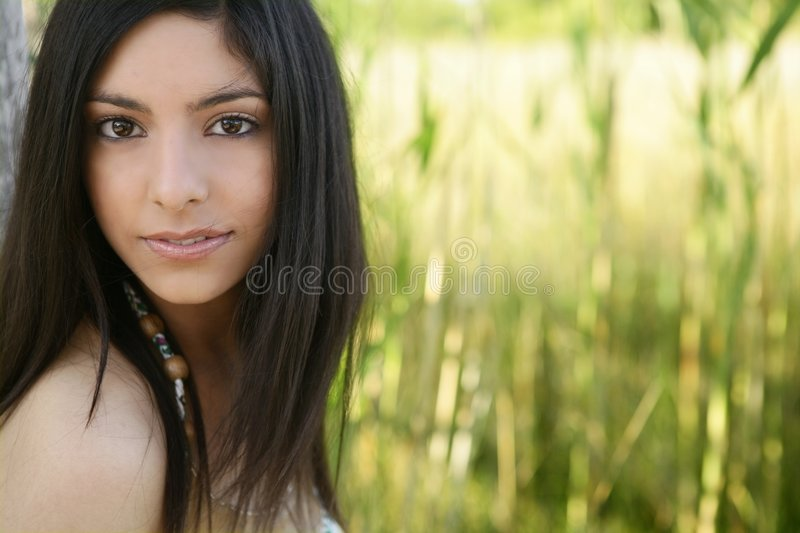 Portrait of beautiful indian woman on nature royalty free stock photos