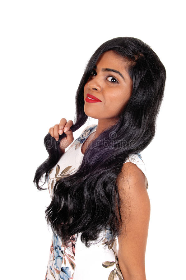 Portrait of beautiful Indian woman. A beautiful young Indian woman standing in a summer dress with long black hair, isolated for white background stock images