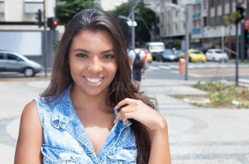 Portrait of a beautiful latin american woman in jeans jacket royalty free stock images