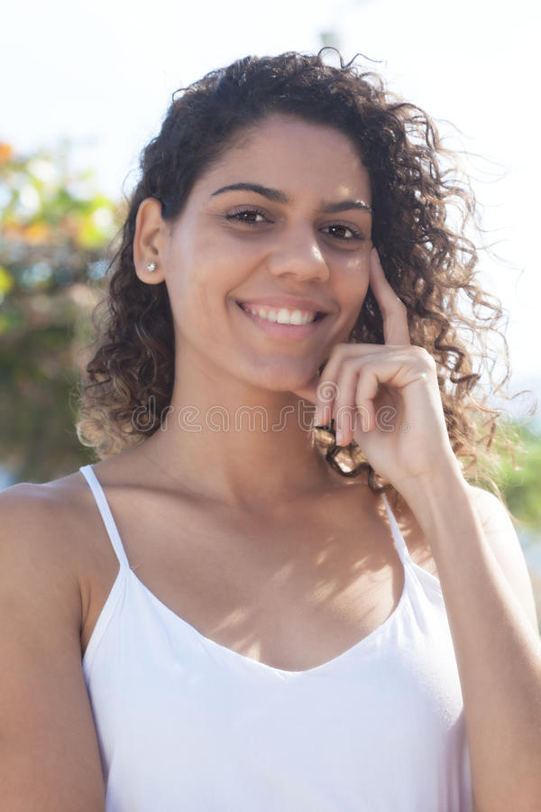 Portrait of a beautiful latin woman in the city royalty free stock photo