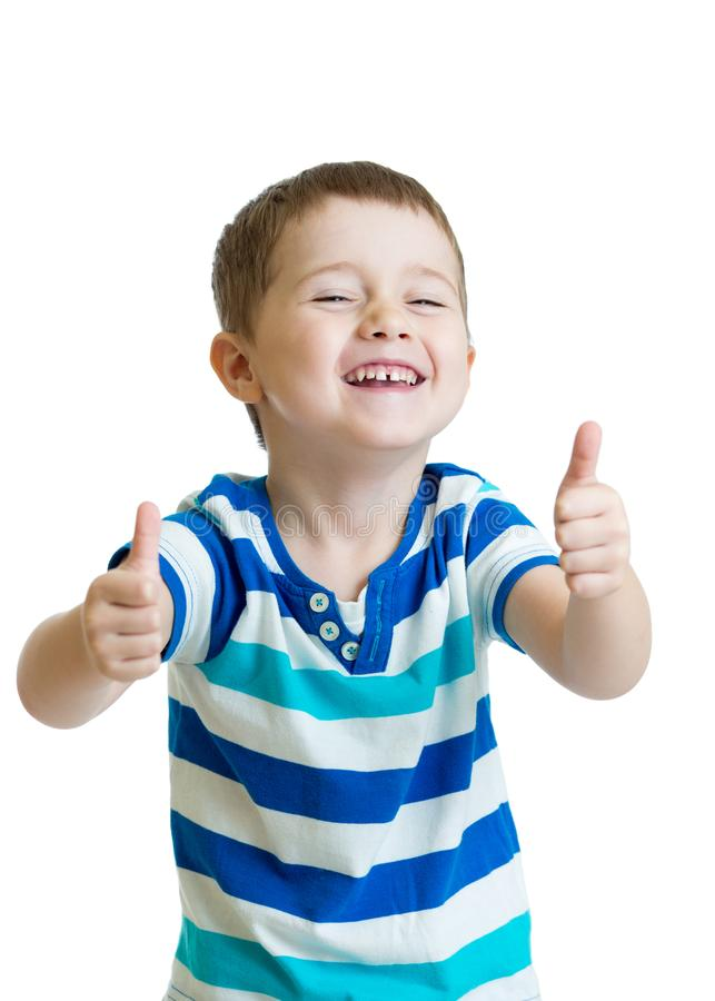 Portrait of beautiful little boy giving you thumbs up over white background stock images