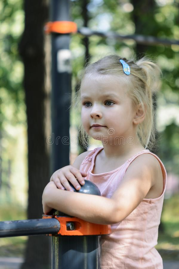 Portrait of a beautiful little girl with blond hair. stock photo