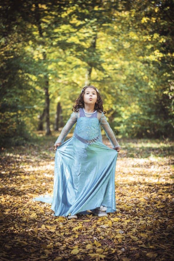 Little fashionable girl. Portrait of beautiful little girl in blue dress stock image