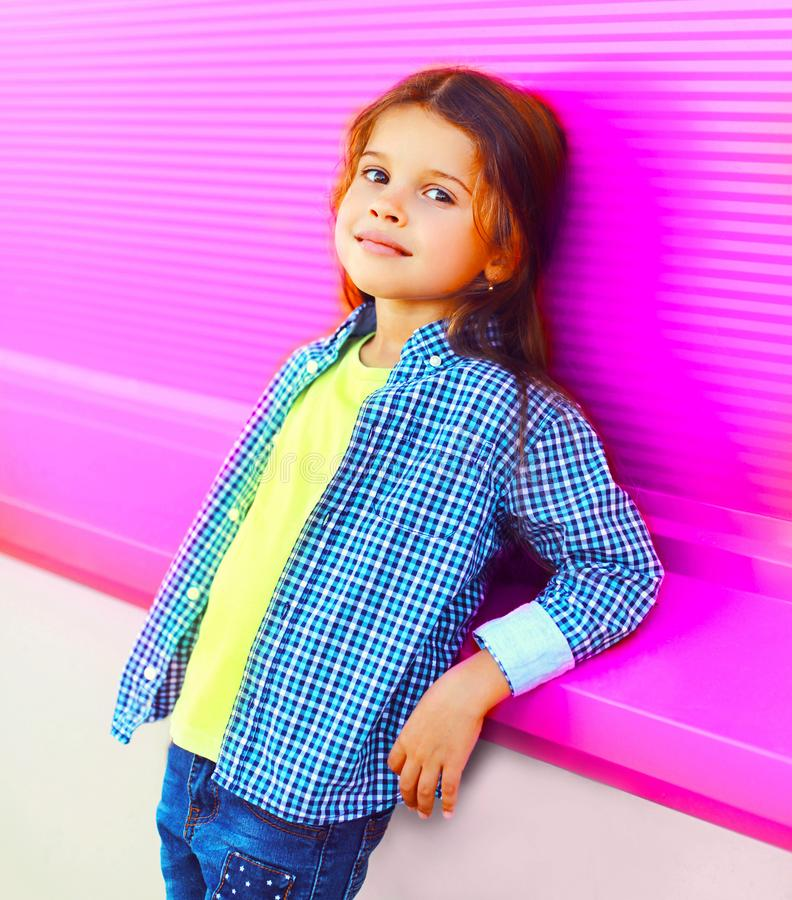 Portrait beautiful little girl child on colorful pink wall royalty free stock photography