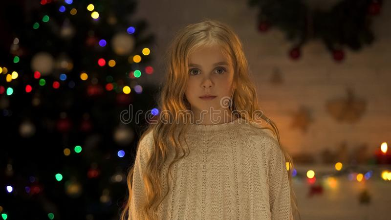 Portrait of beautiful little girl at Christmas eve, faith in miracle, childhood stock photos