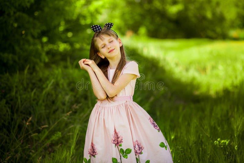 Portrait of beautiful little girl in elegant dress stock photo