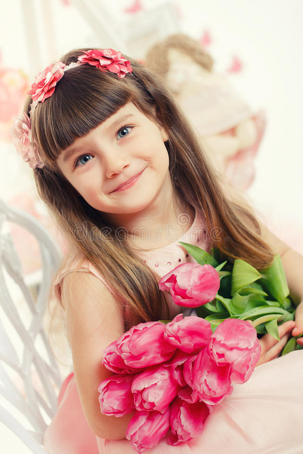 Download Portrait Of A Beautiful Little Girl With Flowers Stock Photo - Image: 38783512