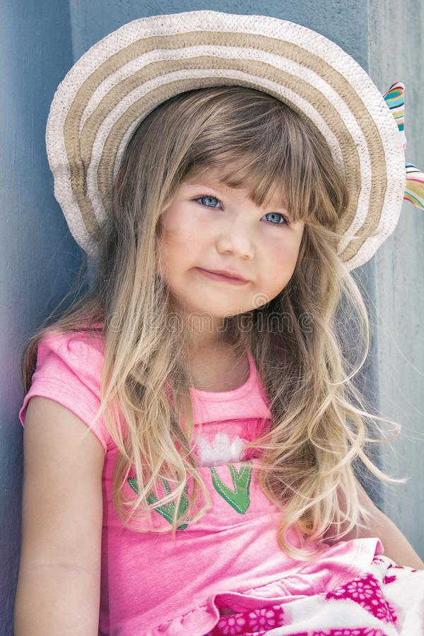 Portrait of a beautiful little girl in a hat royalty free stock images