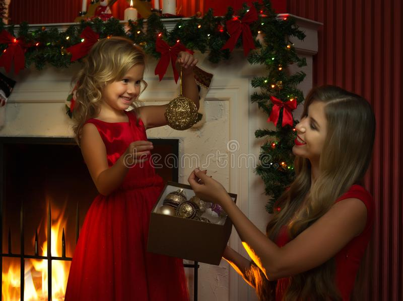 Girl with her mama in christmas environment royalty free stock photography