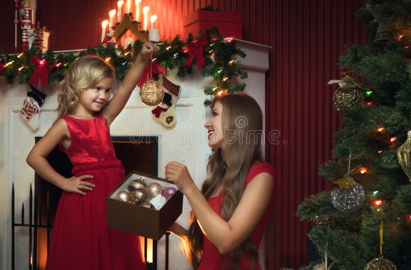 Girl with her mama in christmas environment stock photo