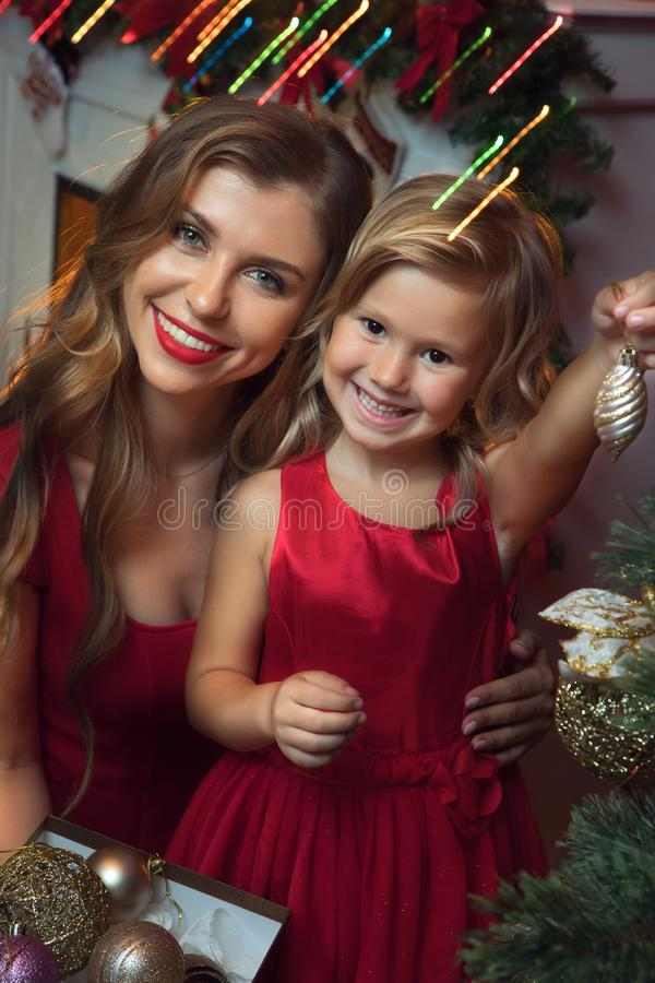 little girl with her mama in christmas environment royalty free stock images