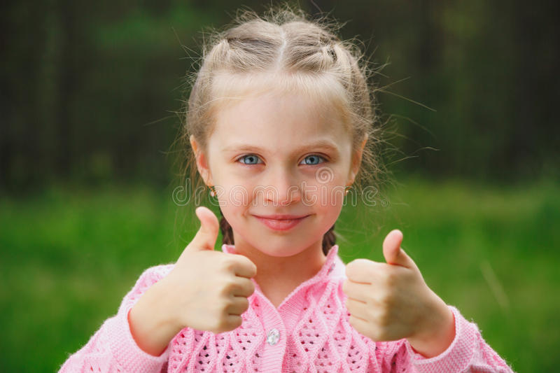 Portrait of the beautiful little girl on nature royalty free stock images