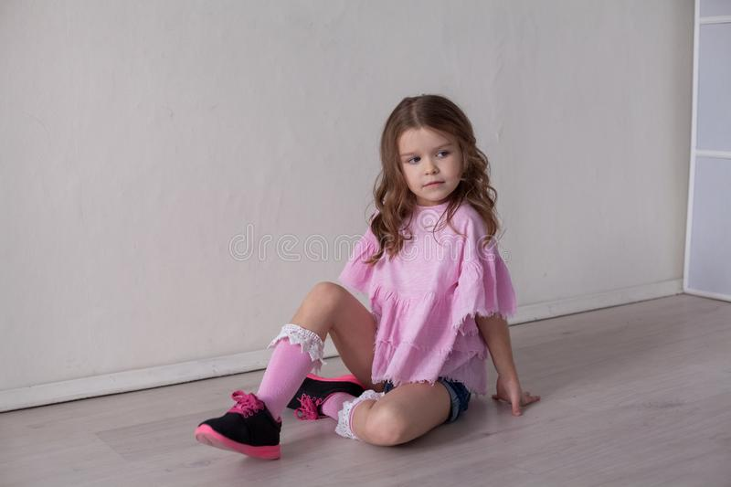 Portrait of a beautiful little girl in a pink dress five years stock photography
